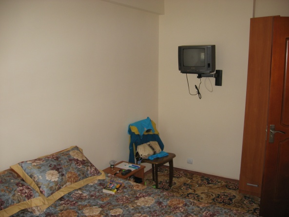Спальня номера люкс пансионата Марко Поло